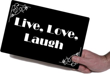 Holding Live Love Laugh movie board photo booth prop