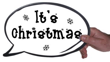 Holding it's Christmas photo booth speech bubble prop