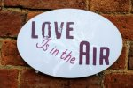 Love is in the Air photo booth sign for weddings
